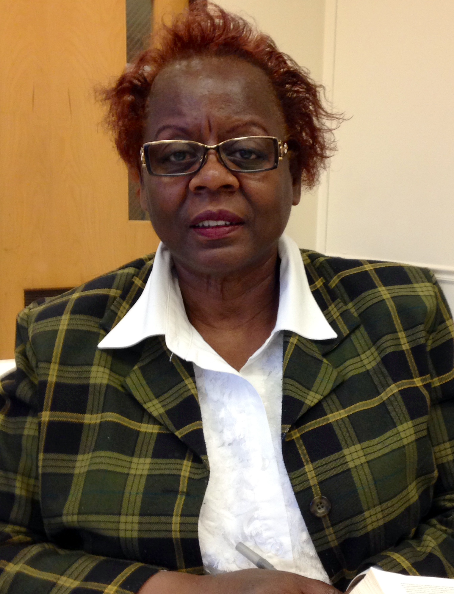 Photo of Marjorie Felder Taylor, African American middle-aged woman with glasses, short hair, in business suit.