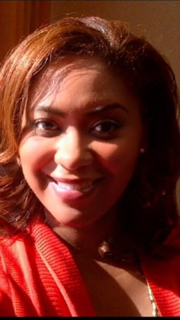 Photo of Shansa, a young African American woman with shoulder-length hair.
