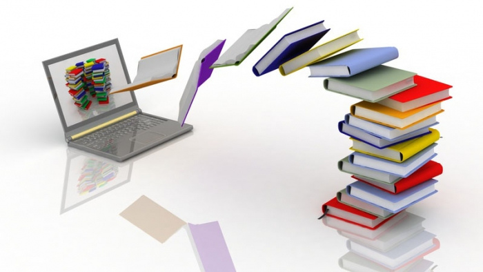 Books flowing into a laptop monitor