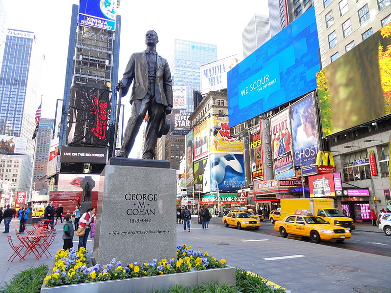 "The George M. Cohan statue in Times Square in New York City. The statue's pedestal reads, ""George M Cohan 1878-1942 Give my Regards to Broadway."