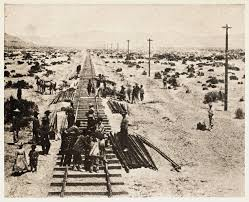 Historical photo of the laying down of railroad tracks