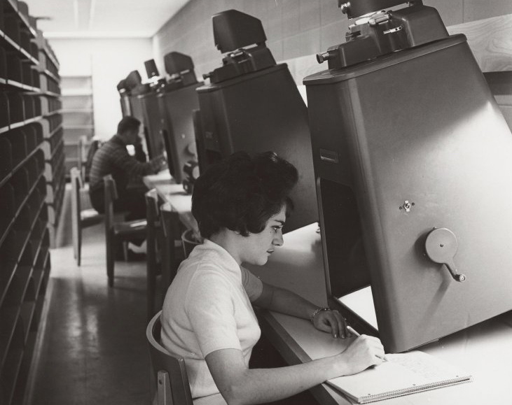 1960s student using a microfilm reader.