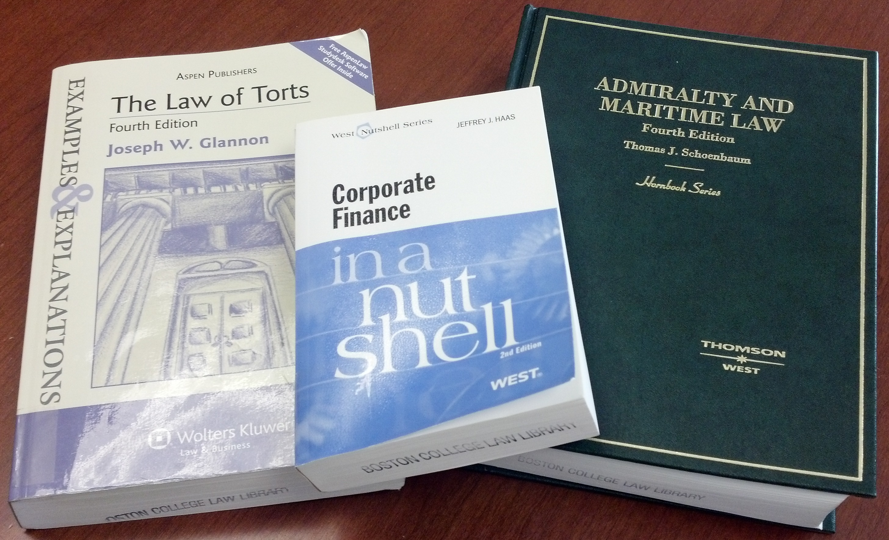 Photograph of Examples and Explanations The Law of Torts, Corporate Finance in a Nutshell, and Admiralty and Maritime treatise