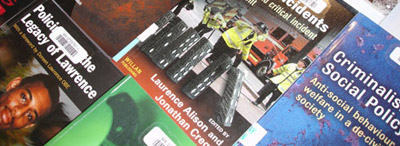 Front covers of several criminoliogy library books