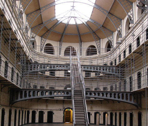 Interior of Victorian prison showing stairs up to balconies outside cell doors