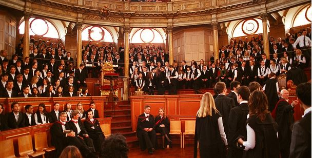 Students entering the Sheldonian theatre for their matriculation ceremony at the University of Oxford. Photograph by Toby Ord on 18 Oct 2003. cc-by-sa-2.5
