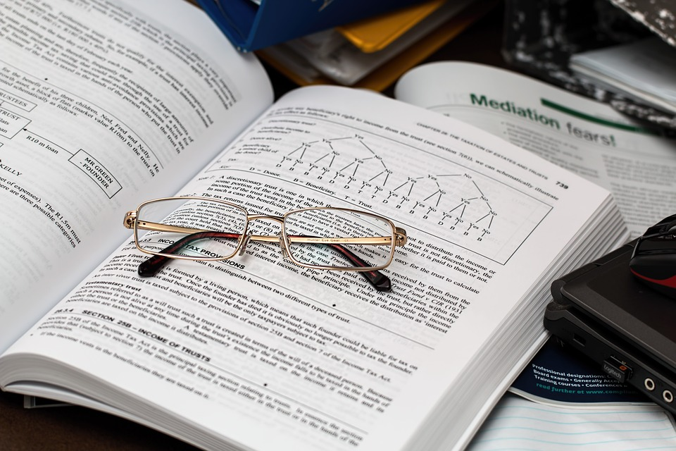 reading glasses on taxation book