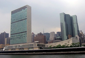 "United Nations Headquarters view from the East River. On the right, skyscraper ""United Nations Plaza"""