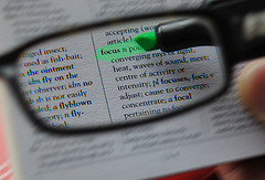 Image of looking through a magnifying glass at text