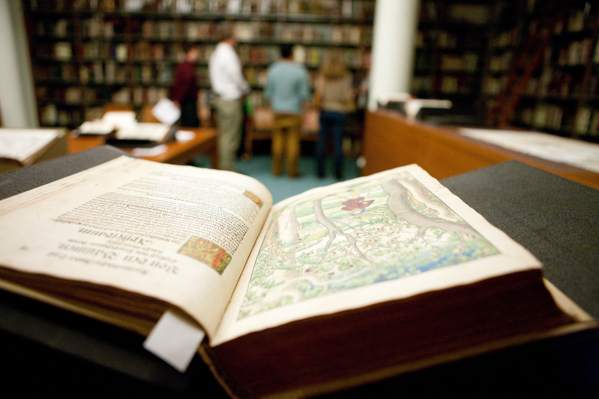 Image of open book in Rare book room