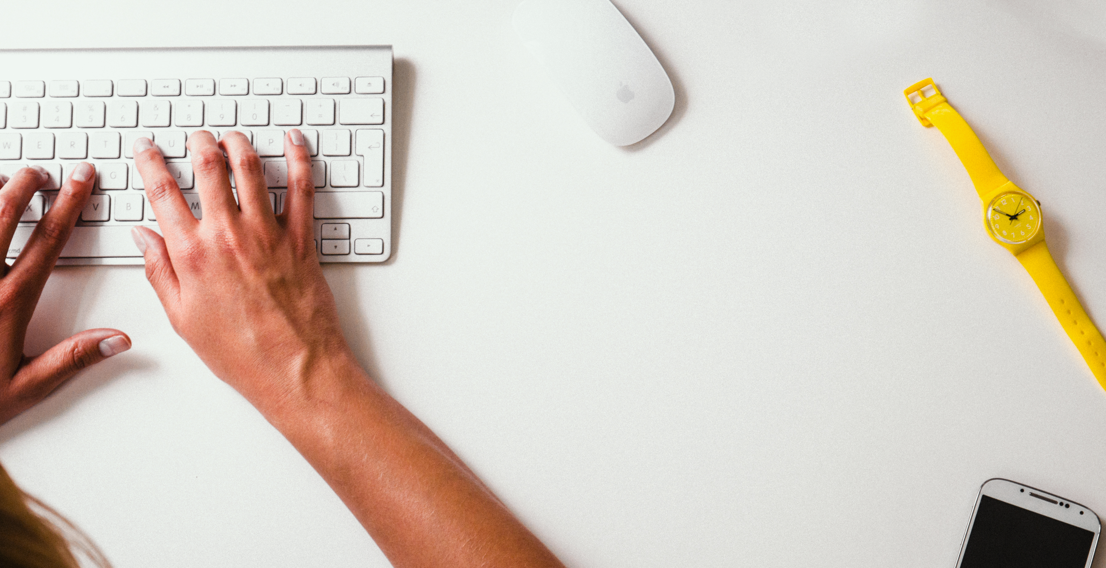 Photograph of person typing on keyboard