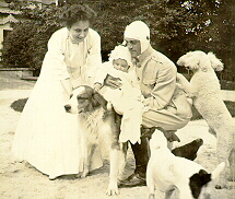 Image from Archive Collections: photograph from Brasova Collection depicting Countess Brasova and Grand Duke Michael Alexandrovich with their son George and dogs at the Grand Duke's estate of Brasovo, 1911