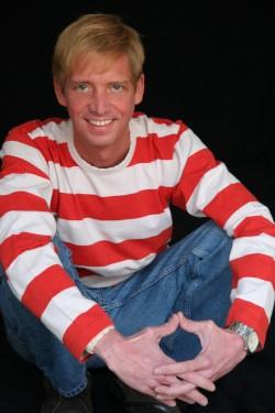 Photograph of Ian Falconer sitting.