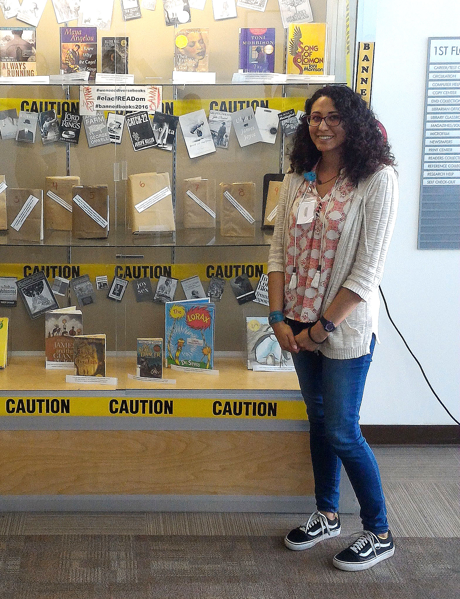 "Fall 2016 Intern Jessi Gutierrez in front of her ""Banned Books"" library display."