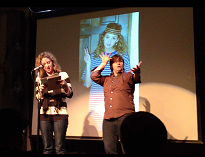 image of poetry reading with sign language interpreter