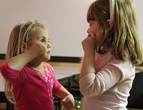 image of small children learning sign language