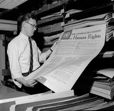 """Historic photo of a man holding the """"Universal Declaration of Human Rights"""""""