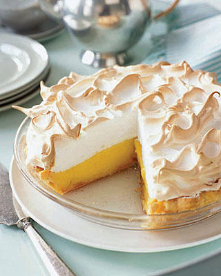 lemon meringue pie with slice missing