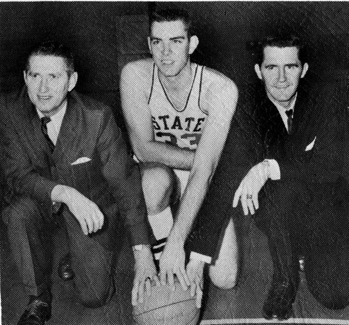 Coach Babe McCarthy, Team Captain Joe Dan Gold, and Assistant Coach Jerry Simmons pose for a photograph.