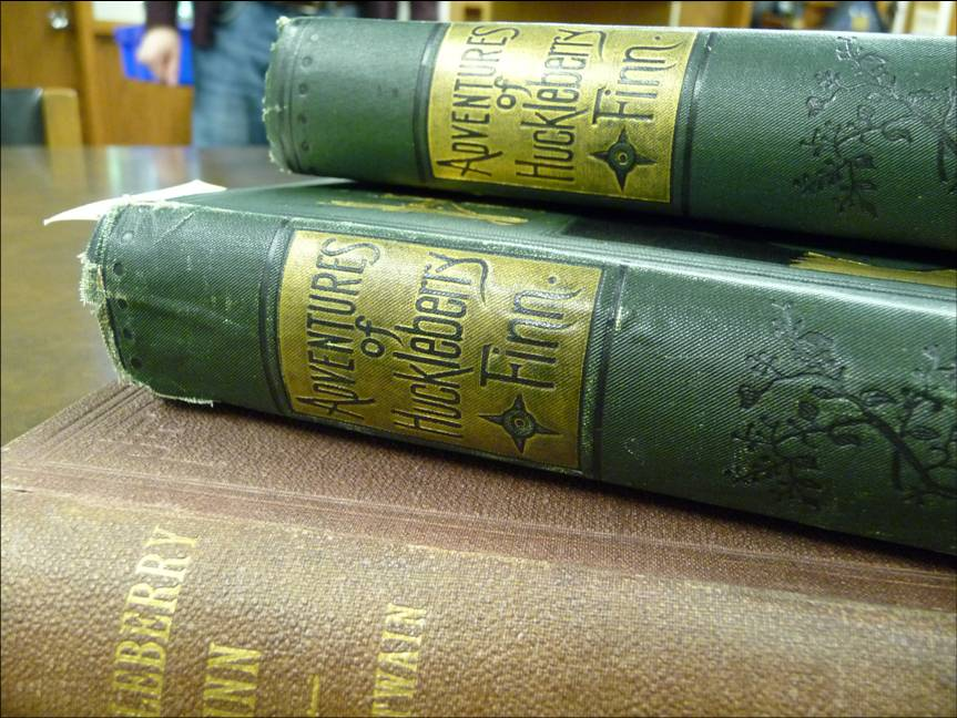 First editions of Twain's Adventures of Huckleberry Finn. Photograph by Eleanor Mills.