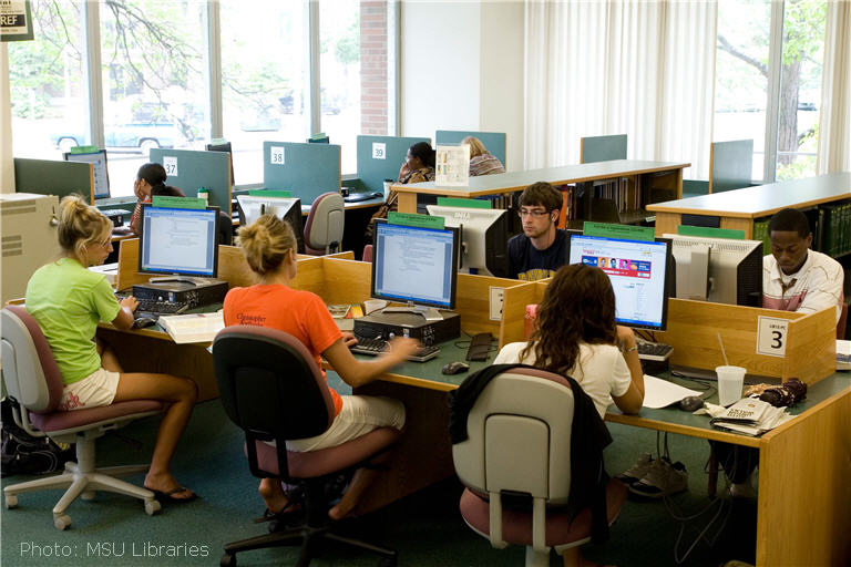 Students working at computers in library