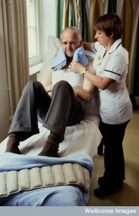Hospital physiotherapist; patient having physiotherapy
