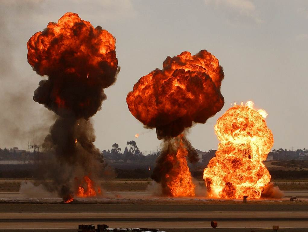 Photograph of a series of very large explosions.