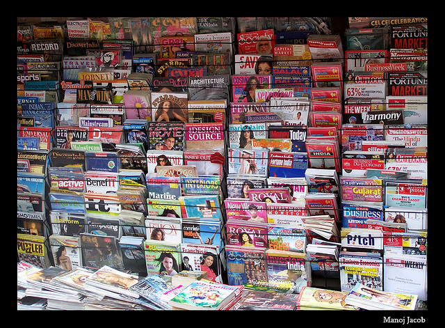 Multiple magazines with covers facing out on display. Image from Flickr by Mannobhai