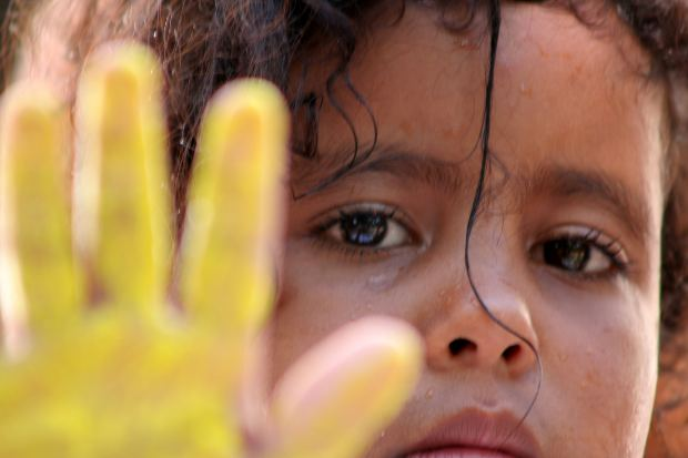 Photo of a girl with paint on her hand