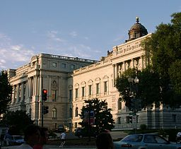 the main building of the library of congress against a blue sky