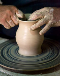 throwing a pot on the wheel