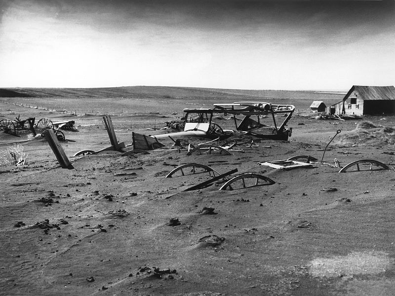 The Dust Bowl in the 1930s A car, wagon parts, and wheels buried in sand