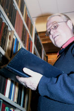 Classics Scholar Dr Terry Ryan consults Lucretius in the Tanner Library