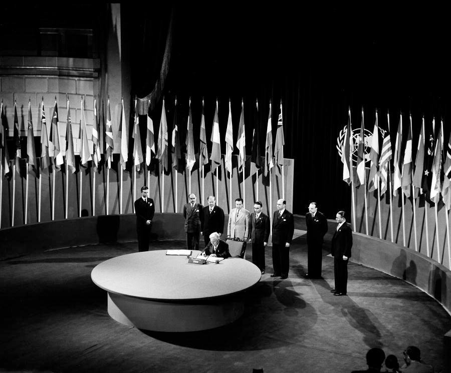 Faris El-Khouri, Prime Minister; Deputy for Damascus; Chairman of the Delegation from Syria, signing the UN Charter at a ceremony held at the Veterans' War Memorial Building on 26 June 1945.
