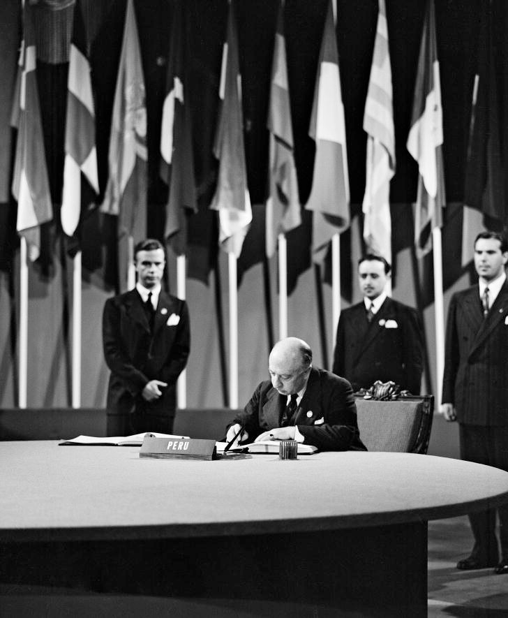 Manuel C. Gallagher, Minister of Foreign Affairs; Chairman of the Delegation from Peru, signing the UN Charter at a ceremony held at the Veterans' War Memorial Building on 26 June 1945.