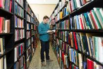 Student standing in SSA bookstacks