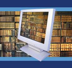 Computer monitor with books on shelf on screen and in background