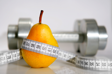 Image of a pear with measuring tape and a dumbbell in background
