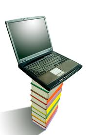 Laptop on top of a stack of books