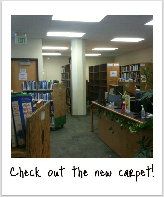 New library carpet and books being reshelved