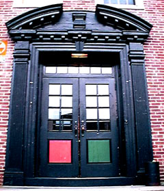 Door of New Africa House some years ago, painted in red, black and green