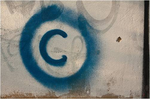 Image of spray-painted copyright logo