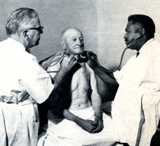 "Picture of Henry Lee ""Buddy"" Treadwell treating a patient"