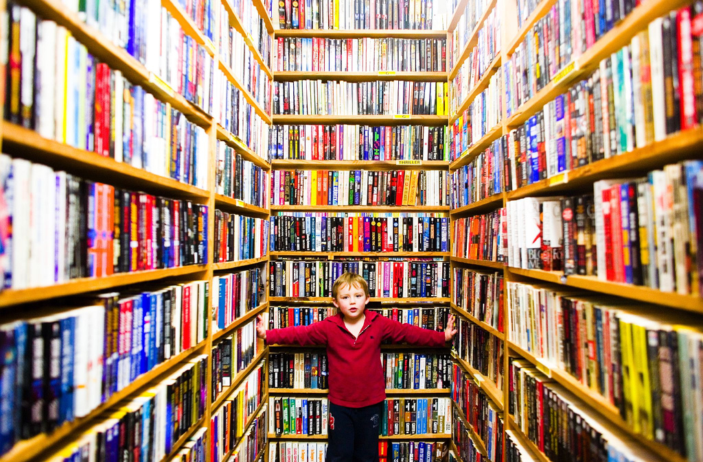 picture of boy in Library with a lot of books