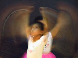 Toddler dancing arms raised