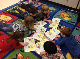children reading a new book together