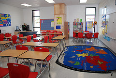 Modern classroom with a rug showing a map of the world