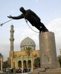 A statue of Saddam Hussein is torn down in Baghdad on April 9 2003