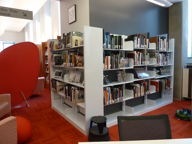 Shelves of POYI books in the Journalism Library