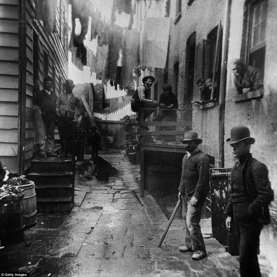 A group of men loitering in an alley known as 'Bandit's Roost' off Mulberry Street 1887